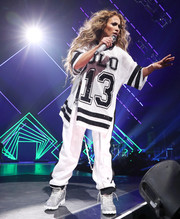 Jennifer Lopez got sporty in a football jersey for her performance at the 2018 DirecTV Now Super Saturday Night concert.