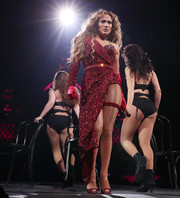 Jennifer Lopez was red-hot in this fully beaded, asymmetrical dress by Nicolas Jebran while performing at the 2018 DirecTV Now Super Saturday Night concert.