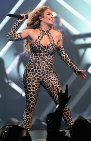 Jennifer Lopez looked purr-fectly sexy in a leopard-print catsuit while performing at the 2018 DirecTV Now Super Saturday Night concert.