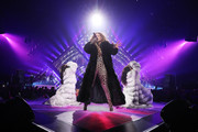 Jennifer Lopez glammed up her leopard-print catsuit with a black fur coat for her performance at the 2018 DirecTV Now Super Saturday Night concert.