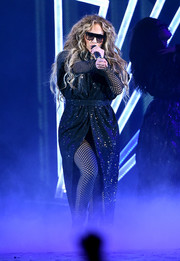 Jennifer Lopez layered a glittering wrap dress over a fishnet catsuit for her performance at the 2018 DirecTV Now Super Saturday Night concert.