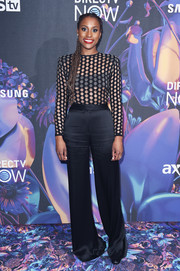 Issa Rae completed her outfit with a pair of black flare pants.