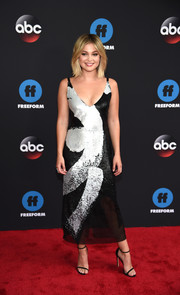 Olivia Holt finished off her look with a pair of black Stuart Weitzman Nudist sandals.