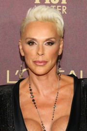 Brigitte Nielsen rocked a platinum-blonde fauxhawk at the 2018 Entertainment Weekly pre-Emmy party.