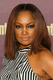Garcelle Beauvais attended the 2018 Entertainment Weekly pre-Emmy party wearing a straight center-parted hairstyle.