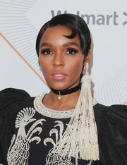 Janelle Monae wore a neat, short hairstyle with a Superman curl at the Essence Black Women in Hollywood Awards.
