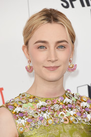 Saoirse Ronan's Piaget chandelier earrings and embellished dress at the 2018 Film Independent Spirit Awards were a vibrant combination!