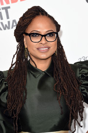 Ava DuVernay wore her dreadlocks in a half-up style at the 2018 Film Independent Spirit Awards.