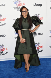 Ava DuVernay sealed off her look with a pair of gold pumps by Stella Luna.