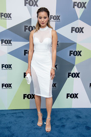 Jamie Chung flaunted her slim physique in a form-fitting white dress at the 2018 Fox Network Upfront.