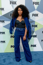 Angela Bassett looked fabulous, as always, in a cobalt suit with feathered sleeves at the 2018 Fox Network Upfront.