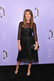 A crystal-embellished satin clutch by Roger Vivier polished off Nina Garcia's ensemble.