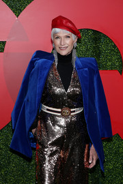 Maye Musk styled her sparkling jumpsuit with a Gucci logo belt for the 2018 GQ Men of the Year party.
