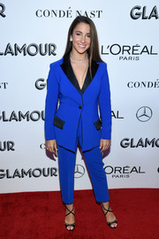 Aly Raisman completed her look with black cross-strap sandals.