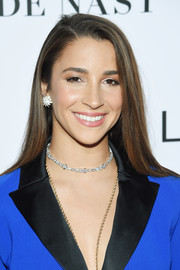 Aly Raisman wore her hair down in a straight side-parted style at the 2018 Glamour Women of the Year Awards.
