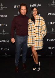 Camila Alves arrived for the 2018 HFPA and InStyle TIFF celebration wearing a grid-patterned coat by Isabel Marant.
