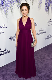 Lacey Chabert styled her dress with a printed clutch.