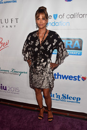 Halle Berry was breezy and boho in a floral mini dress with flutter sleeves at the 2018 Imagine cocktail party.