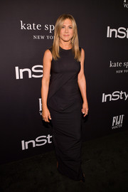 Jennifer Aniston kept it low-key in a structured black column dress at the 2018 InStyle Awards.