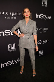 Olivia Culpo styled her suit with strappy silver heels by Christian Louboutin.