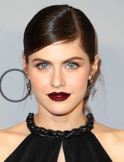 Alexandra Daddario went for a bold beauty look with dark red lipstick.