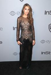 Sistine Rose Stallone showed her daring side in a sheer black gown by Naeem Khan at the Warner Bros. and InStyle Golden Globes after-party.