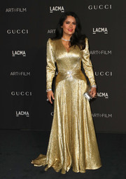 Salma Hayek kept the shine going with a metallic silver clutch.