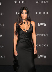 Kim Kardashian matched a black leather purse with a slip dress for the 2018 LACMA Art + Film Gala.