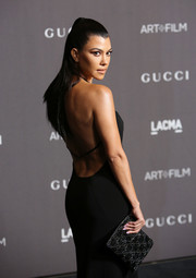 Kourtney Kardashian accessorized with a beaded clutch by Gucci at the 2018 LACMA Art + Film Gala.