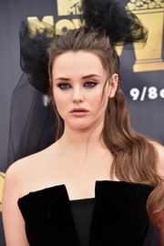 Katherine Langford styled her long locks into a wavy ponytail for the 2018 MTV Movie & TV Awards.