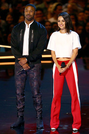 Mila Kunis hit the MTV Movie & TV Awards wearing a cropped tee by Hanes x Karla.