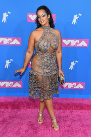 Dascha Polanco completed her look with strappy silver heels by Jimmy Choo.
