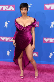 Cardi B complemented her dress with a pair of magenta satin sandals.