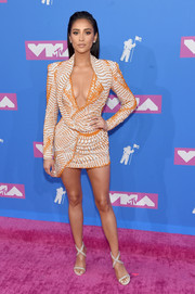 Shay Mitchell showed off her cleavage and legs in a low-cut, beaded mini dress by Nicolas Jebran at the 2018 MTV VMAs.