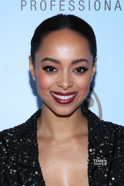 Amber Stevens West finished off her look with a glossy red lip.