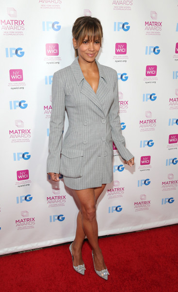 Halle Berry went office-chic in a gray pinstriped tuxedo dress by Eleanor Balfour at the 2018 Matrix Awards.
