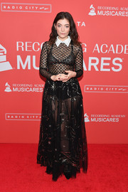Lorde went the sexy route in a sheer black Dior gown with a contrast collar and gold embroidery at the 2018 MusiCares Person of the Year.