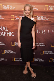 Poppy Delevingne showed off her svelte figure in a black Narciso Rodriguez sheath dress with an asymmetrical neckline and a contrast shoulder strap at the 2018 National Geographic Upfront.