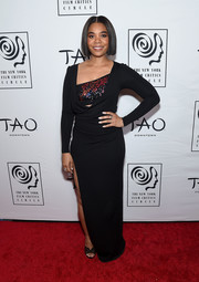 Regina Hall looked vampy in a form-fitting black Cushnie dress with a sequined bodice and a high side slit at the New York Film Critics Circle Awards.