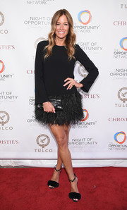 Kelly Bensimon glammed it up in black fur sandals teamed with a feather-hem LBD at the 2018 Night of Opportunity Gala.