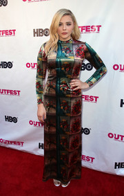 Chloe Grace Moretz attended the 2018 Outfest Los Angeles LGBT Film Festival wearing a colorful floral maxi dress by Stella McCartney.