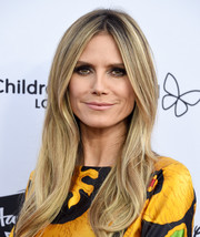Heidi Klum was stylishly coiffed with this loose center-parted 'do at the 2018 From Paris with Love Gala.