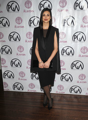 Morena Baccarin tied her look together with a long black patent clutch.