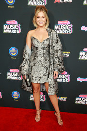 Olivia Holt styled her outfit with gold triple-strap sandals by Giuseppe Zanotti.