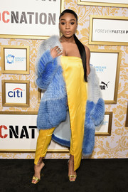 Normani Kordei's blue degradé fur coat and yellow jumpsuit made a gorgeous color combo!