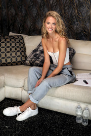 Kate Bock pulled her outfit together with a pair of white leather sneakers.