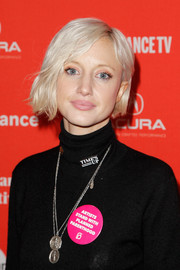 Andrea Riseborough's platinum-blonde bob looked striking against her black outfit at the Sundance premiere of 'Burden the Park.'