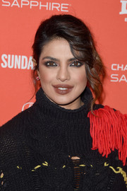 Priyanka Chopra styled her hair into a chignon with wavy tendrils cascading down one side for the Sundance premiere of 'A Kid Like Jake.'