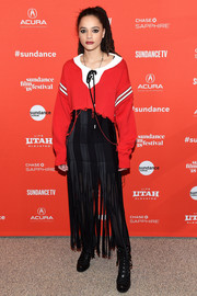 Sasha Lane was sporty in a red Monse scoopneck sweater with a contrast neckline, striped sleeves, and ribbon detailing at the Sundance premiere of 'The Miseducation of Cameron Post.'