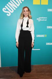 Joanne Froggatt finished off her outfit with a pair of loose black trousers.